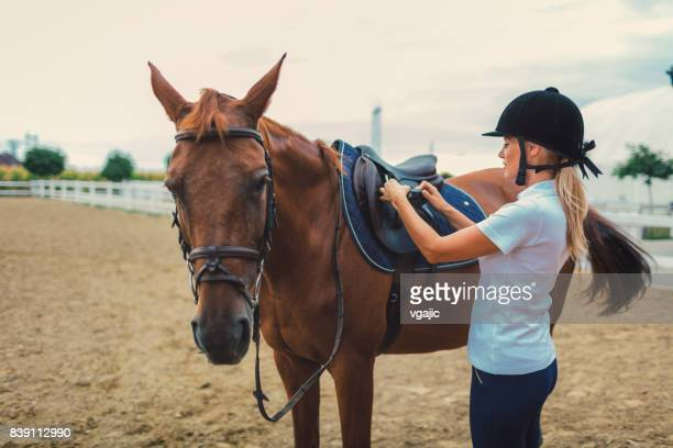 Female rider with her horse