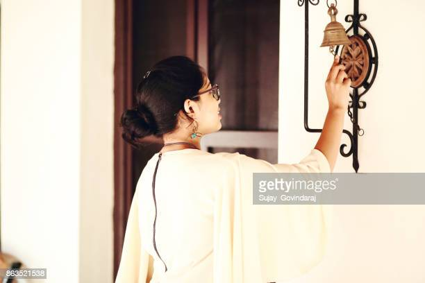 Female Ringing the Door Bell