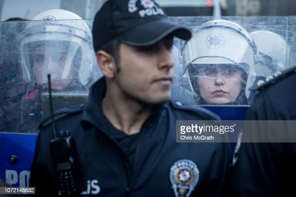 Female riot police block protesters from marching down Istiklal street during a demonstration marking International Day for the Elimination of...