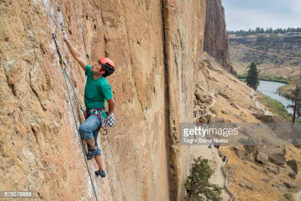 female rock climber at smith rock - smith rock state park stock pictures, royalty-free photos & images