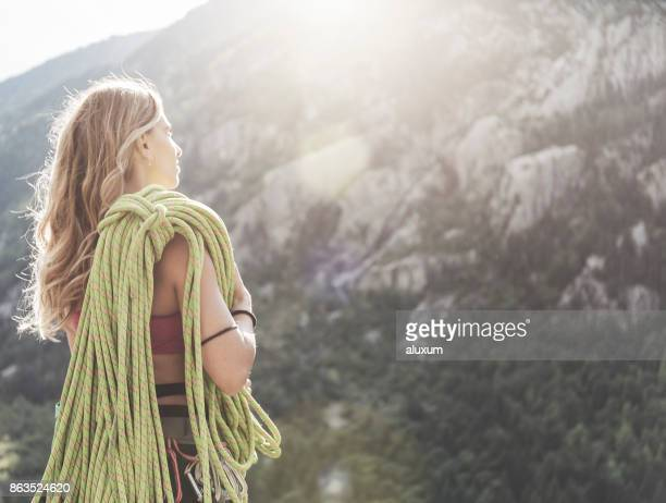 Female rock climber in the mountains