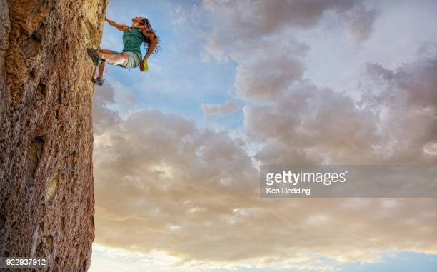 Female Rock Climber on Rock Wall