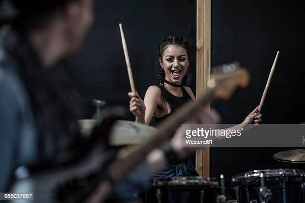Female rock drummer at recording studio