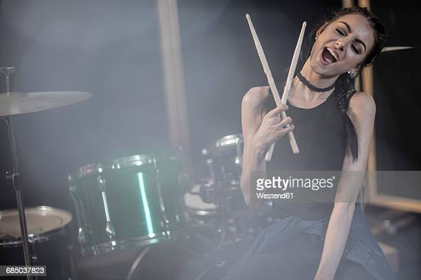 female rock drummer at recording studio - drummer stock photos and pictures