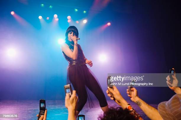 Female rock star performing in front of audience