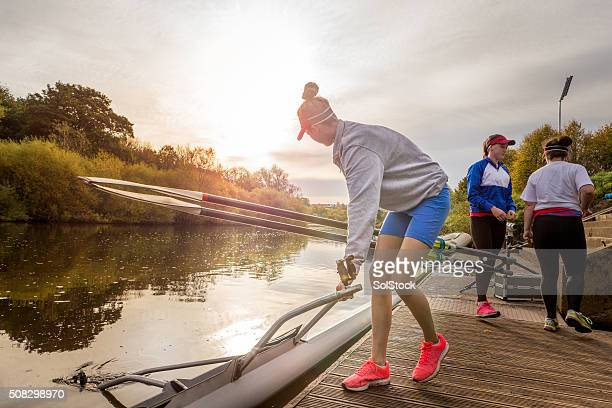 Female rower putting her boat in the water