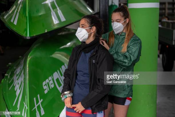 Female rower, wearing a protective face mask prepares the braid to another one before the training session in March, on June 08, 2020 in Hondarribia,...