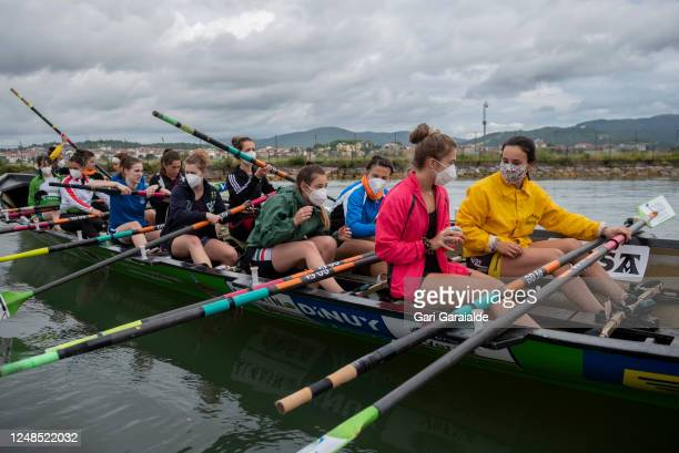 Female rowers with protective face masks get ready for the first training session since the confinement began in March on June 08 2020 in Hondarribia...