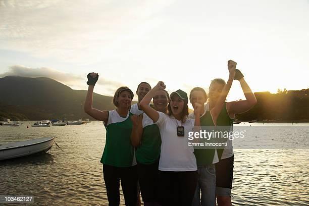 female rowing team celebrating