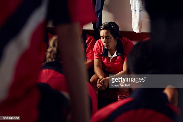 Female rugby player getting ready before match