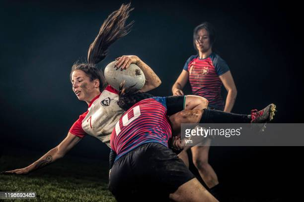 female rugby player getting tackled - only women stock pictures, royalty-free photos & images