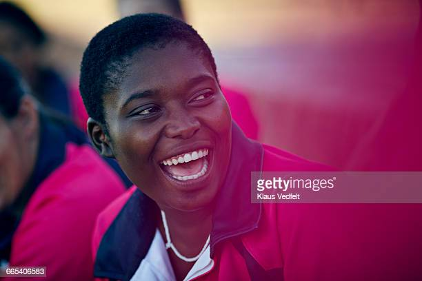 female rugby player laughing among teammates - leanincollection stock pictures, royalty-free photos & images