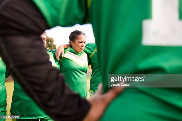 female rugby players have team talk at side of pitch - grittywomantrend stock photos and pictures