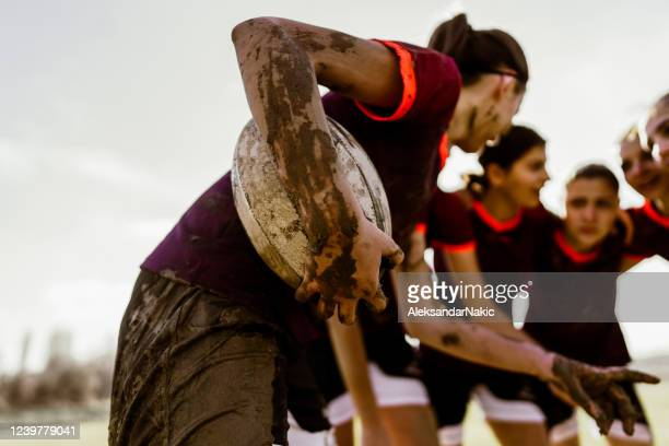 female rugby players making a plan of playing - rugby stock pictures, royalty-free photos & images