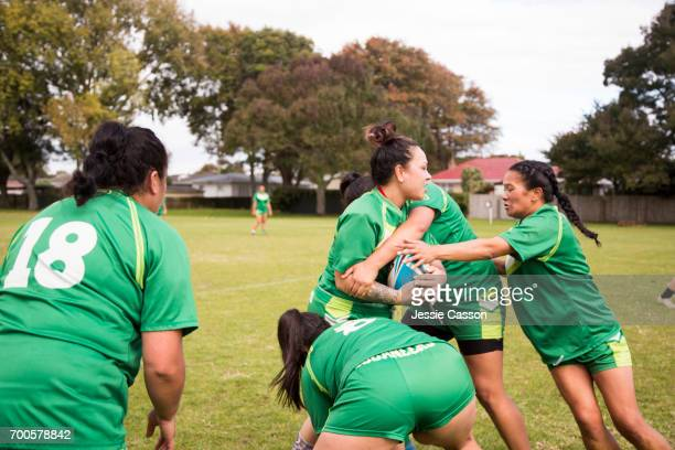 female rugby players tackling in action - grittywomantrend stock photos and pictures