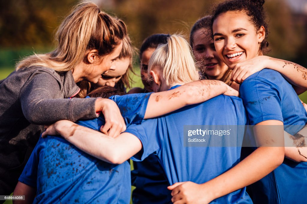 Female Rugby Players Together in a Huddle : Stock Photo