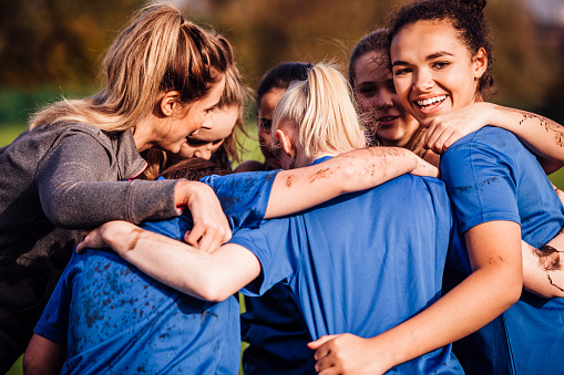 Female Rugby Players Together in a Huddle 648944056