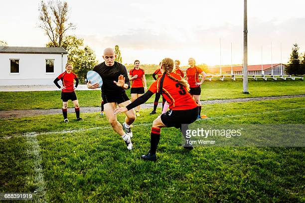 Female rugby tackling training