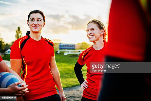 Female Rugby Team Player Talking Together