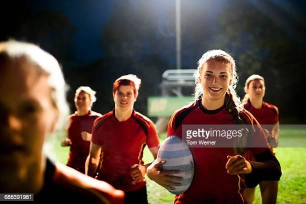 female rugby team running together - rugby sport bildbanksfoton och bilder