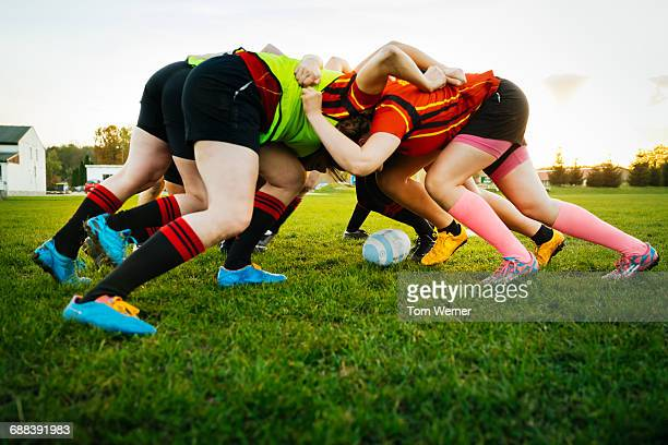 female rugby team training how to block - rugby team stock pictures, royalty-free photos & images