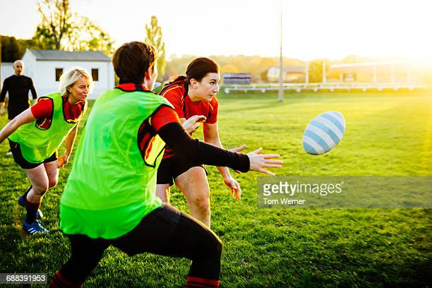 Female rugby team training outdoors
