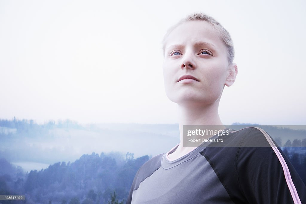 Female runner about to start run in open country : Stock Photo