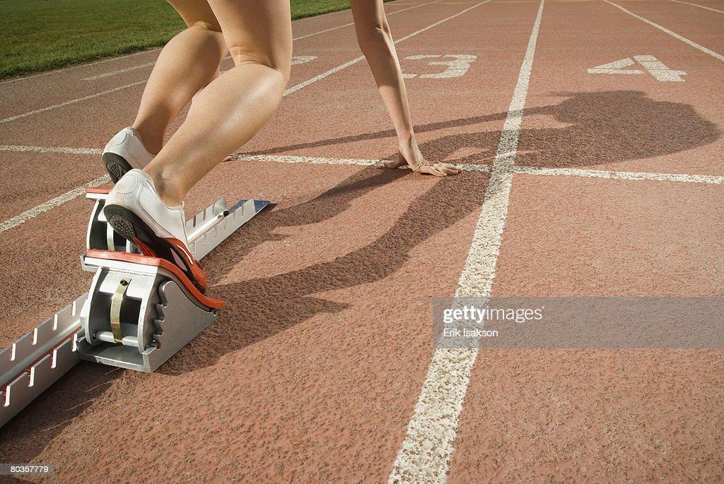 Female runner at starting block, Utah, United States : Stock Photo