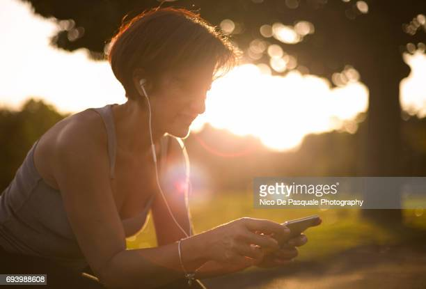 female runner at the park - watch what happens: live stock pictures, royalty-free photos & images