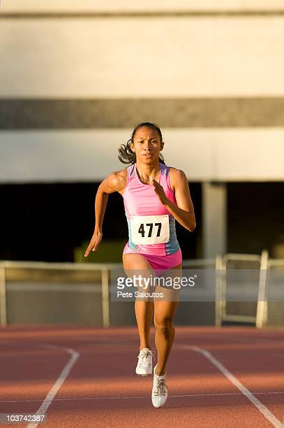 female runner competing on racetrack - filipino ethnicity and female not male stock pictures, royalty-free photos & images
