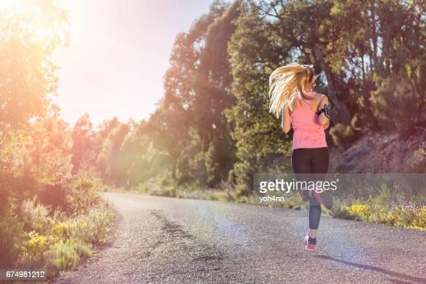 Female runner exercising outside