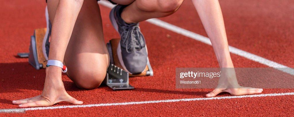 Female runner in starting position, : Stock Photo