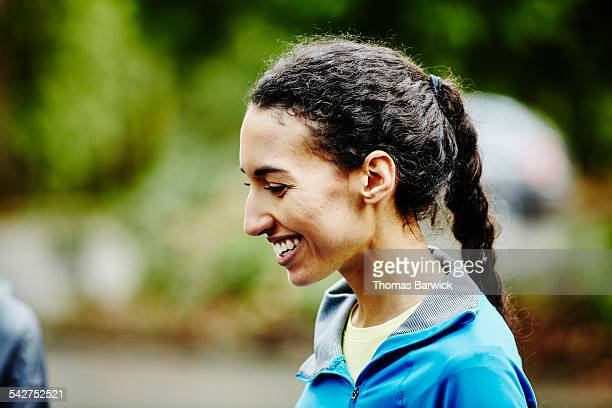 Female runner laughing with friends after run