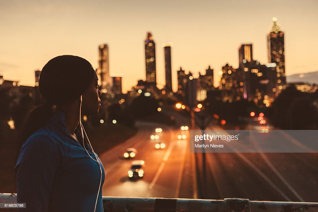 female runner looking out to the skyline : Stock Photo