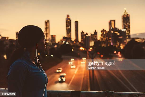 female runner looking out to the skyline - atlanta skyline stock pictures, royalty-free photos & images