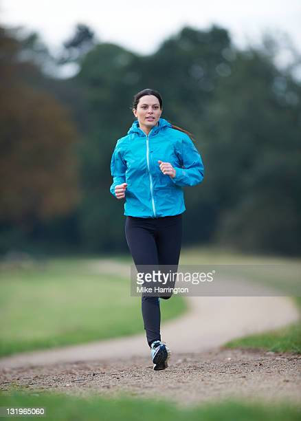 female runner - jogging stock photos and pictures