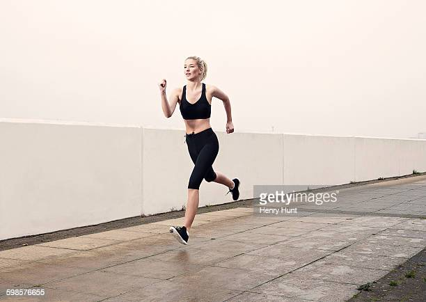 female runner - one young woman only stock pictures, royalty-free photos & images