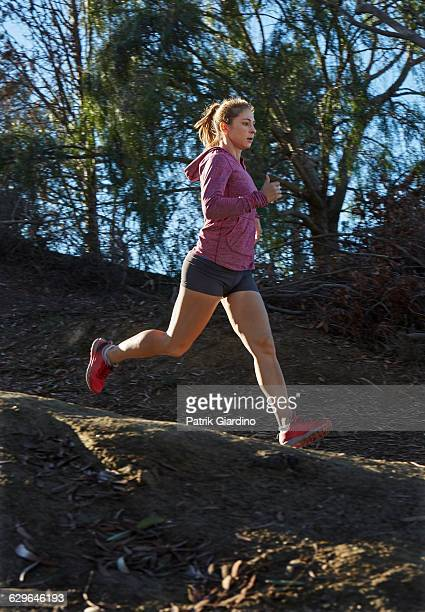 female runner - striding stock pictures, royalty-free photos & images