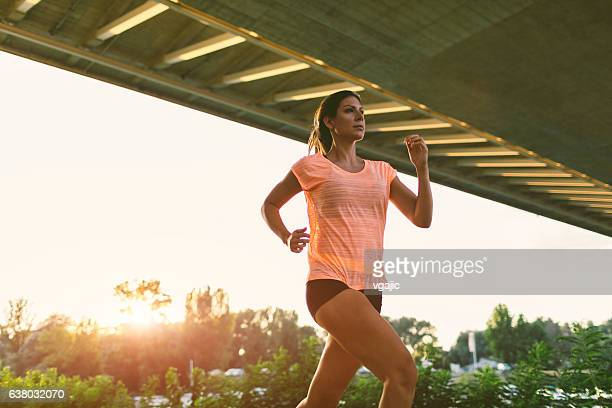 female runner. - running shorts stock pictures, royalty-free photos & images