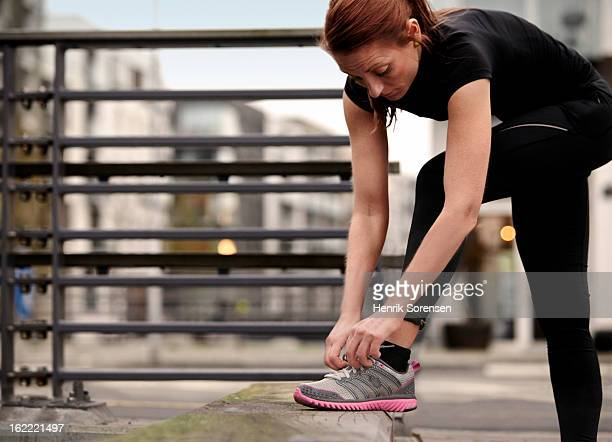 female runner preparing