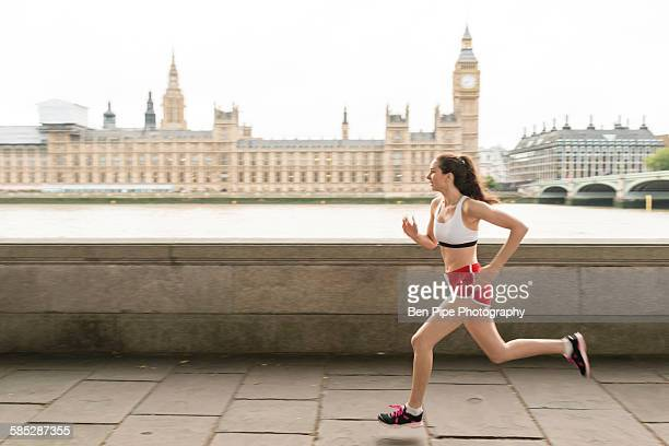 Female runner running on Southbank, London, UK