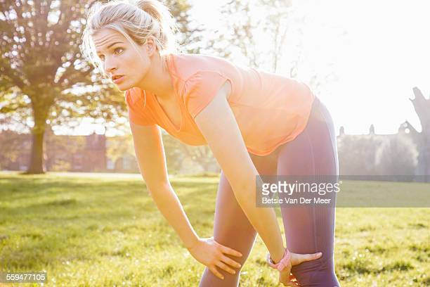 Female runner stretching in park