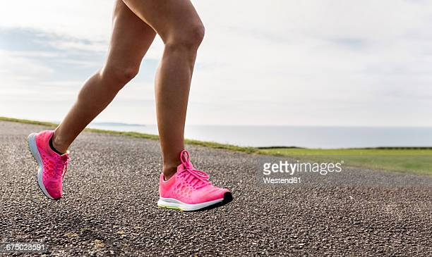 female runner training outdoor - low section stock pictures, royalty-free photos & images
