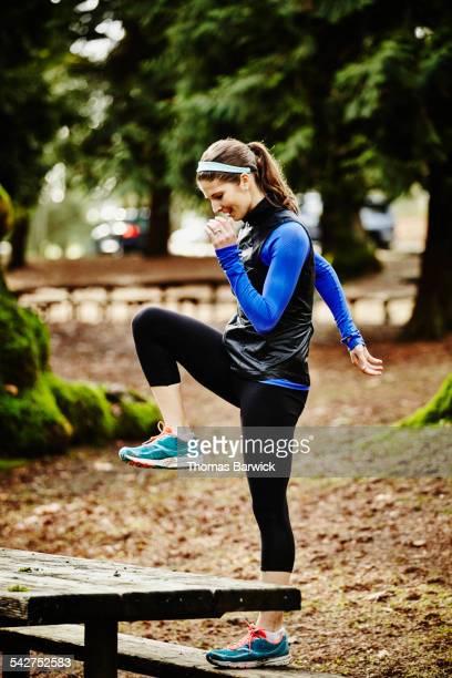 Female runner warming up before morning run