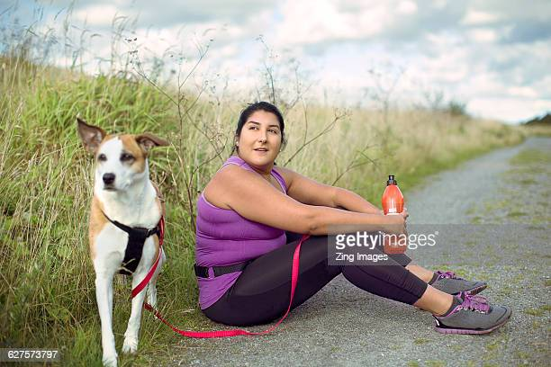 female runner with dog - fat lady in leggings stock photos and pictures