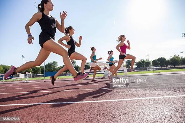 Female runners on tartan track