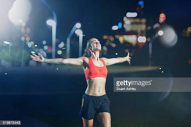 Female running in city park