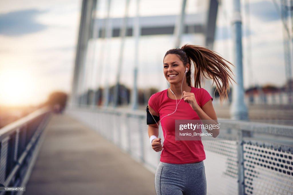 Female running in the city : Stock Photo