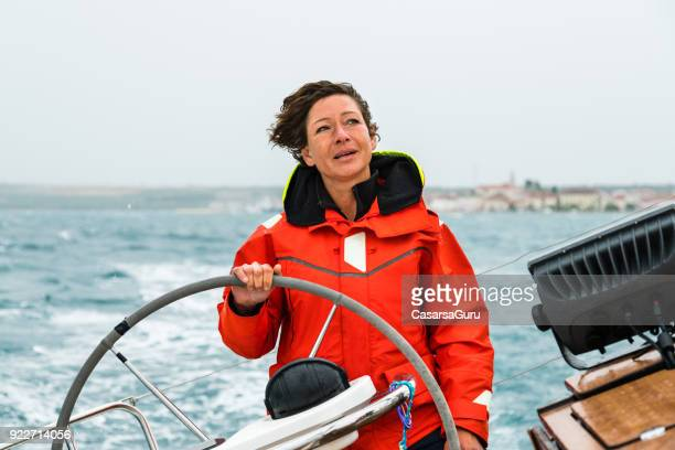 female sailboat skipper portrait - sailing team stock pictures, royalty-free photos & images