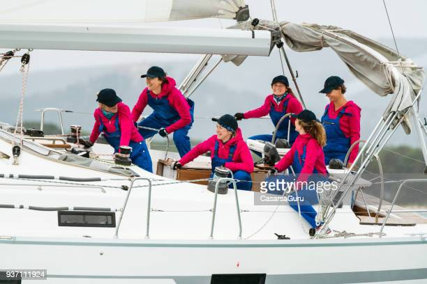 female sailing crew posing on a sailing boat - sailing team stock pictures, royalty-free photos & images